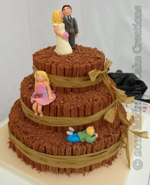 Relaxed chocolate flake themed cake with sugar models of the family - Midnight Cake Creations