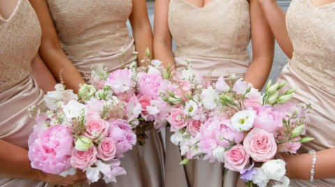 blush and cream bridesmaid's posies - The Flower Farm