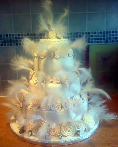Feathered four tier - Amethyst Cakes