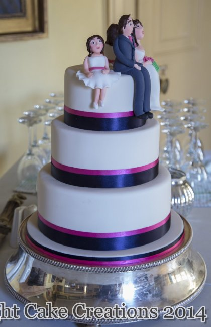 Simple wedding cake with ribbon to match the wedding accessories and topped with sugar models - Midnight Cake Creations