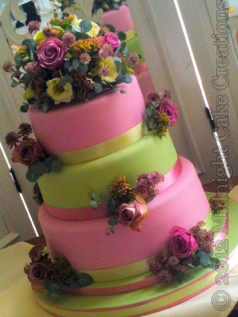 Beautiful pink and green pastel cake decorated with fresh flowers to match the wedding flowers - Midnight Cake Creations