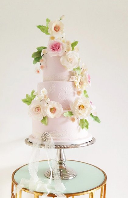 Sugar Roses on this Rose Quartz and lace wedding cake - Cobi & Coco Cakes
