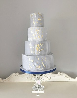 Dare to be different with our striking four tier marble cake. With crips edges and gold leaf detail, this cake is guaranteed to impress