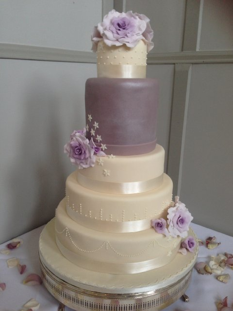Five tier wedding cake with dummy tiers and sugar flowers