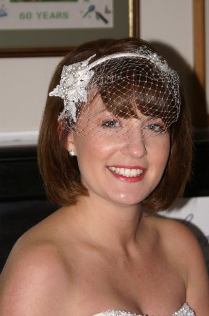 birdcage veil over ivory lace flower tiara