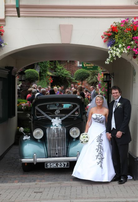 Bride and Groom at the Courtyard entrance to the Greyhound Lutterworth - The Greyhound Coaching Inn and Hotel