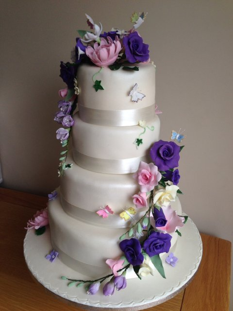 Four tier wedding cake with handmade sugar flowers