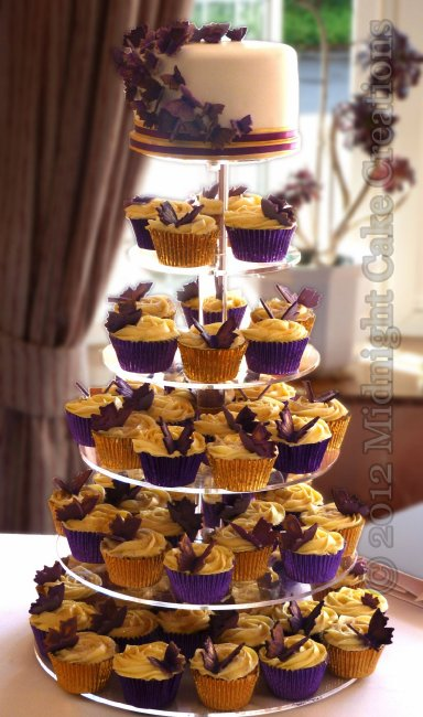 Purple themed butterfly cupcake tower with a cutting cake swathed with matching butterflies - Midnight Cake Creations