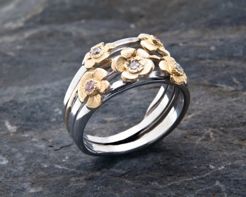 18ct white gold wedding ring with pink and white diamonds and recycled gold flowers