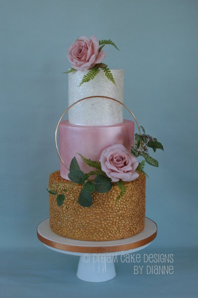 3 tier Tier Wedding Cake with a modern design. Floral hoop with a textured metallic gold, pretty pink lustre and a shiny glittery tier. - Dream Cake Designs (Dianne Stanley)