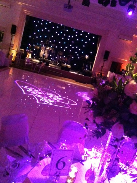 Logo projection and stage backdrop - Lighting for Weddings