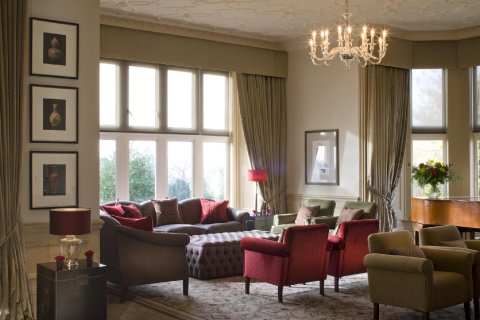 Unwind in our stunning lounge, and enjoy the ambiance of Hartsfield Manor.