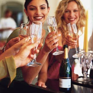 2 ladies cheering with champagne flutes.jpg