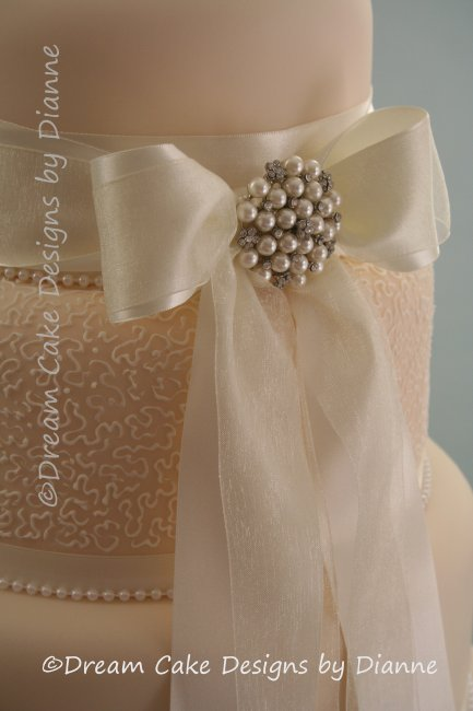 5 Tier Ivory/Cream Wedding Cake with satin and voile bow with a diamante and pearl brooch and delicate hand piped filigree detail - Dream Cake Designs (Dianne Stanley)