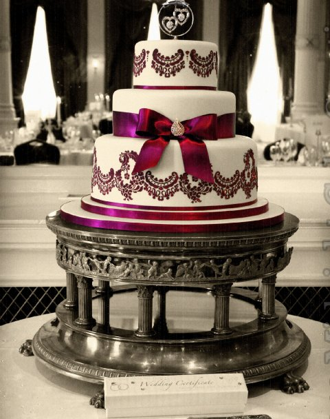 Elegant three tier cake with stencil decoration and coordinating ribbon and bow and beautiful brooch detail - Midnight Cake Creations