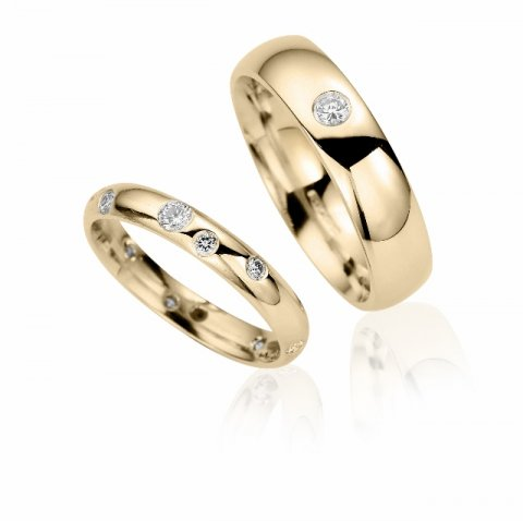 Yellow gold and scattered diamond matching wedding rings
