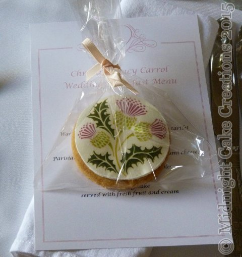 Wedding butter cookie favours decorated with thistles to match the theme of the wedding - Midnight Cake Creations