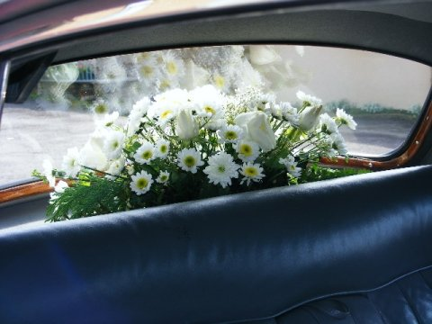 Beautiful ivory wedding car flowers - Bottom Of The Garden Flowers