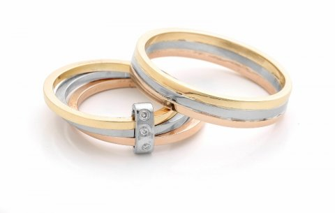 Red, white and yellow gold matching wedding rings