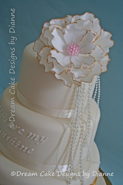 3 Tier White & Gold Wedding Cake with large fantasy flower and pearls. Inspired by 'The Great Gatsby and You are my Sunshine' - Dream Cake Designs (Dianne Stanley)