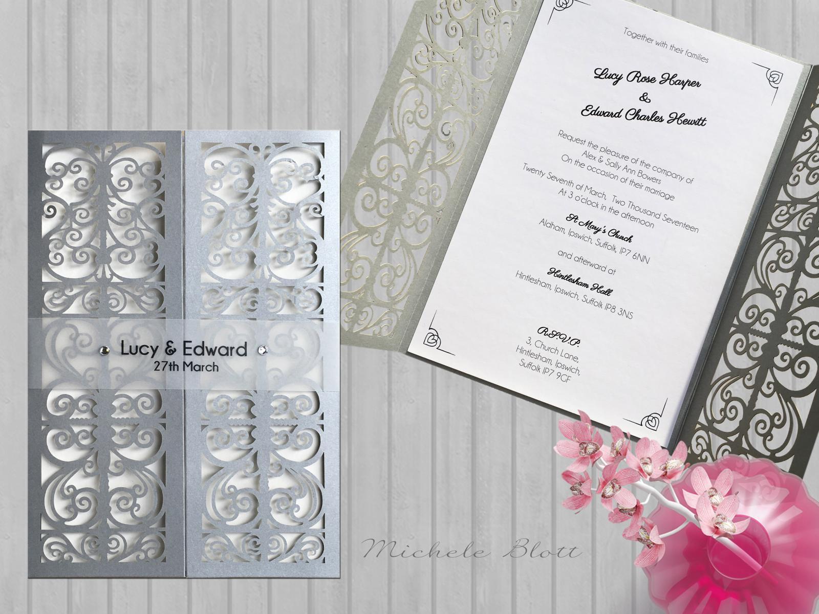 silver_monogram_laser_cut_gatefold_wedding_invitation.jpg