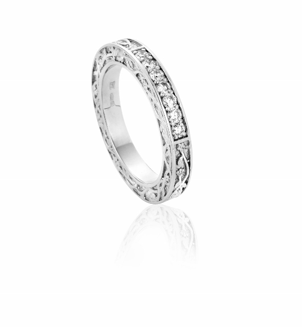 Bespoke Hand carved platinum wedding ring with diamonds by Claire Troughton.jpg