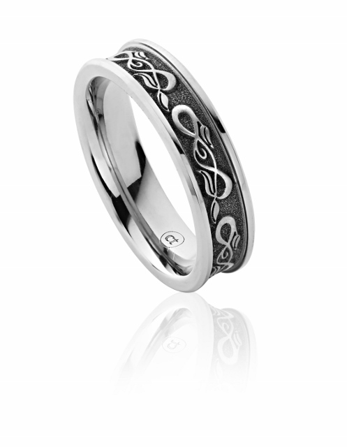 Bespoke titanium laser etched leaf gents wedding ring by Claire Troughton.jpg